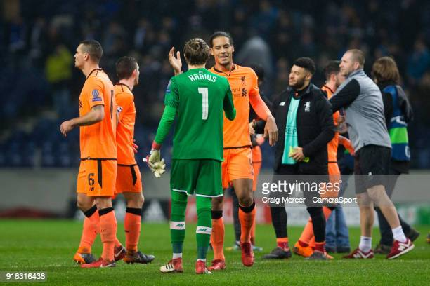 Liverpool's Virgil van Dijk celebrates with team mate Loris Karius at full time during the UEFA Champions League Round of 16 First Leg match between...