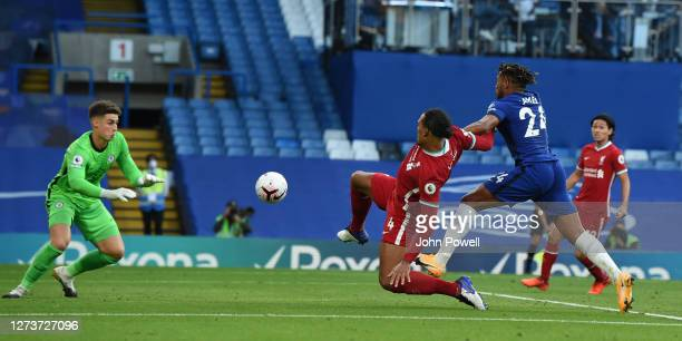Liverpools Virgil van Dijk comes close with Kepa Arrizabalaga of Chelsea during the Premier League match between Chelsea and Liverpool at Stamford...