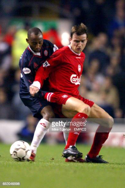 Liverpool's Vladimir Smicer and Sheffield United's Wayne Allison battle for the ball