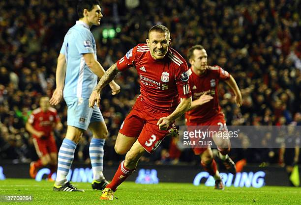 Liverpool's Welsh forward Craig Bellamy celebrates after scoring during the English League cup semi final second leg football match between Liverpool...