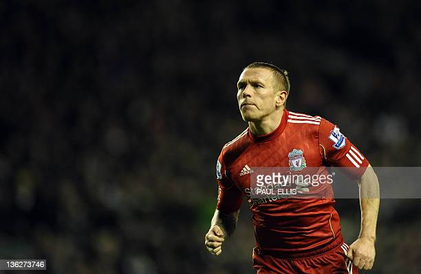 Liverpool's Welsh forward Craig Bellamy celebrates scoring during the English Premier League football match between Liverpool and Newcastle United at...