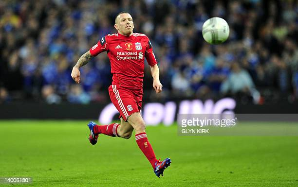 Liverpool's Welsh forward Craig Bellamy chases down a ball against Cardiff in the League Cup Final at Wembley Stadium in London, on February 26,...