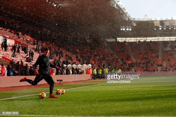 Liverpool's Welsh goalkeeper Danny Ward warms up in the snow ahead of the English Premier League football match between Southampton and Liverpool at...