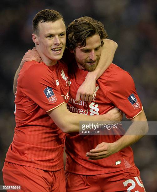 Liverpool's Welsh midfielder Joe Allen celebrates with Liverpool's Australian defender Brad Smith after scoring the opening goal of the English FA...