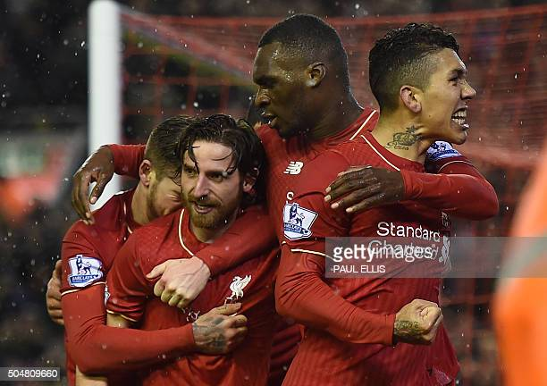 Liverpool's Welsh midfielder Joe Allen celebrates with teammates after scoring during the English Premier League football match between Liverpool and...