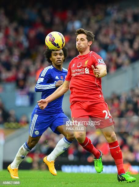 Liverpool's Welsh midfielder Joe Allen controls the ball under pressure from Chelsea's Brazilian midfielder Willian during the English Premier League...