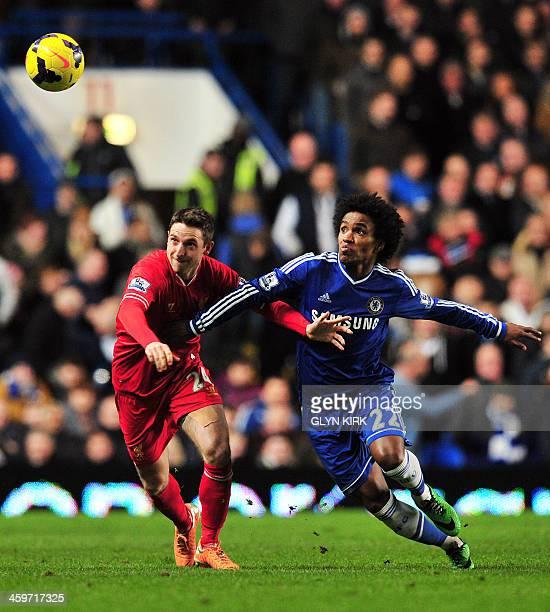 Liverpool's Welsh midfielder Joe Allen vies with Chelsea's Brazilian midfielder Willian during the English Premier League football match between...