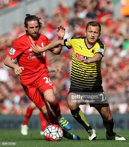 Liverpool's Welsh midfielder Joe Allen vies with Watford's Yugoslavianborn Swiss midfielder Almen Abdi during the English Premier League football...