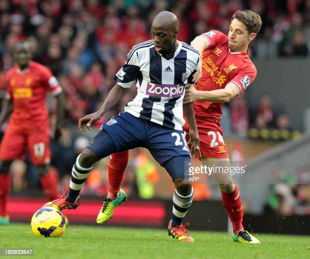 Liverpool's Welsh midfielder Joe Allen vies with West Bromwich Albion's Congolese midfielder Youssouf Mulumbu during the English Premier League...