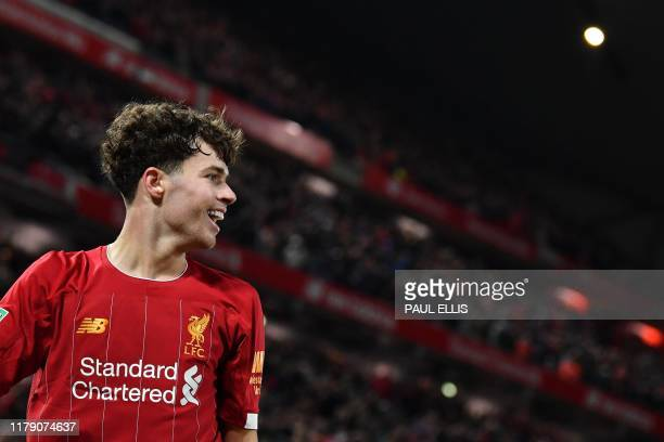 Liverpool's Welsh midfileder Neco Williams reacts after Liverpool's Belgium striker Divock Origi scored his team's fifth goal from his cross during...