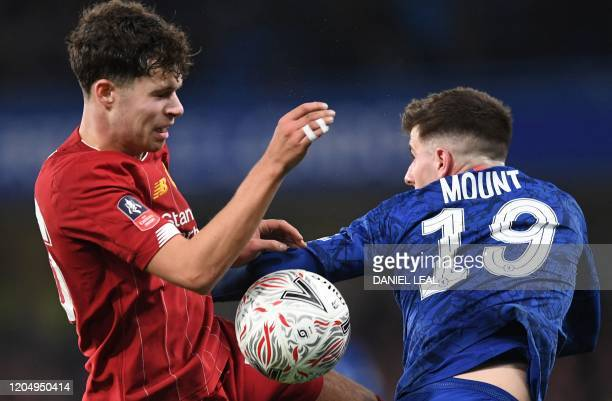 Liverpool's Welsh midfileder Neco Williams vies with Chelsea's English midfielder Mason Mount during the English FA Cup fifth round football match...