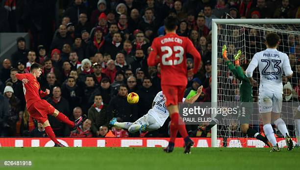 Liverpool's Welsh striker Ben Woodburn scores his team's second goal during the EFL Cup quarterfinal football match between Liverpool and Leeds...