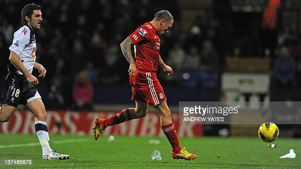 Liverpool's Welsh striker Craig Bellamy scores Liverpool's first goal during the English Premier League football match between Bolton Wanderers and...