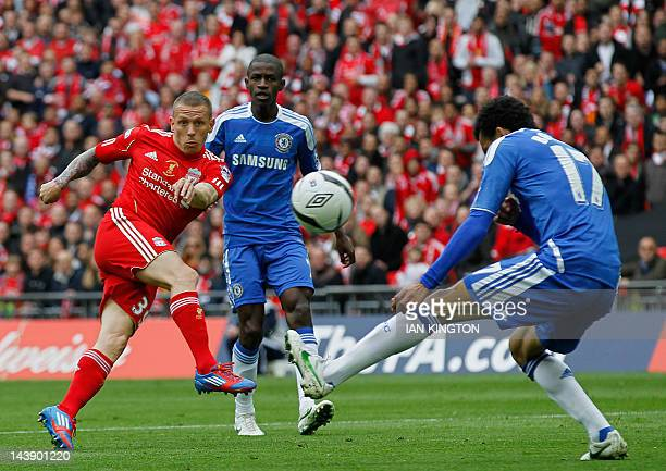 Liverpool's Welsh striker Craig Bellamy shoots during the FA Cup final football match between Liverpool and Chelsea at Wembley Stadium in London,...