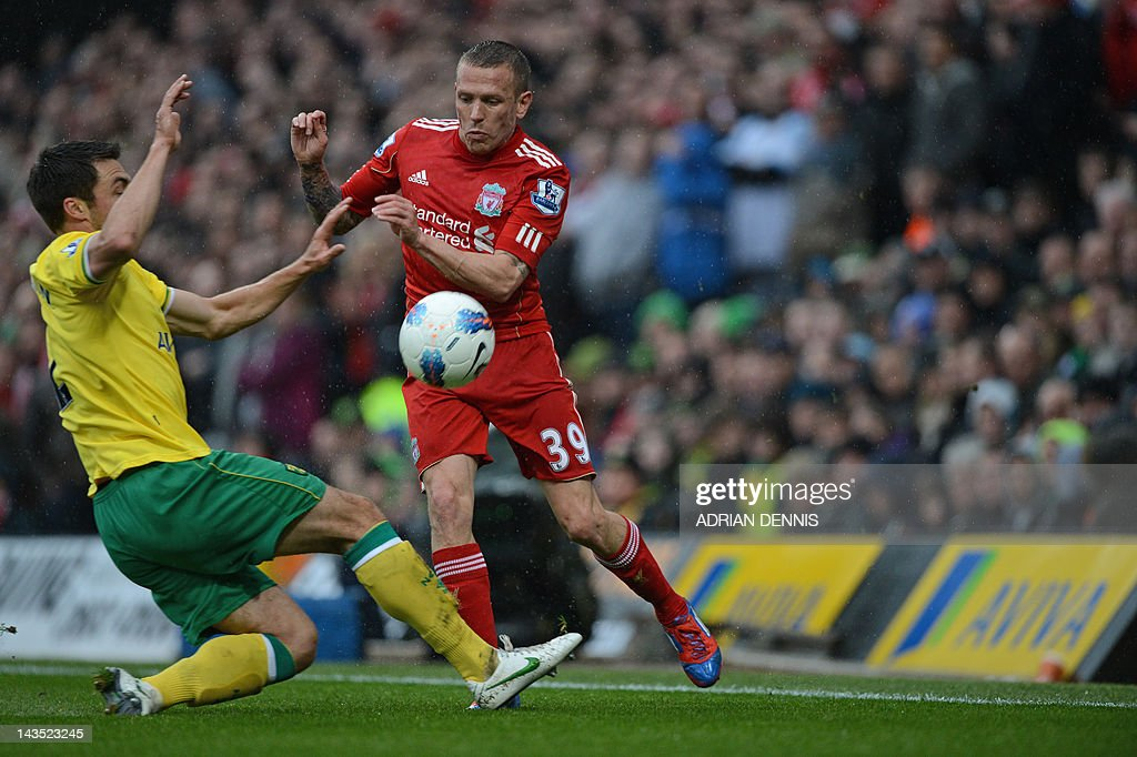 "Liverpool's Welsh striker Craig Bellamy (R) under pressure during the English Premier League football match between Norwich City and Liverpool at Carrow Road stadium in Norwich, England on April 28, 2012. USE. No use with unauthorized audio, video, data, fixture lists, club/league logos or ""live"" services. Online in-match use limited to 45 images, no video emulation. No use in betting, games or single club/league/player publications."