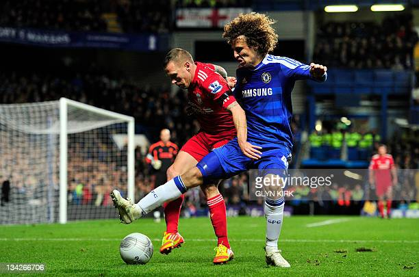 Liverpool's Welsh striker Craig Bellamy vies with Chelsea's Brazilian defender David Luiz during their League Cup football match against Chelsea at...