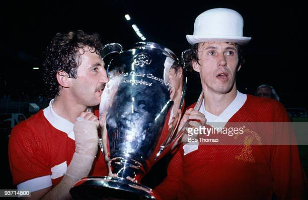 Liverpool's winning goalscorer Alan Kennedy and Phil Neal parade the trophy after the Liverpool v Real Madrid European Cup Final match held at the...