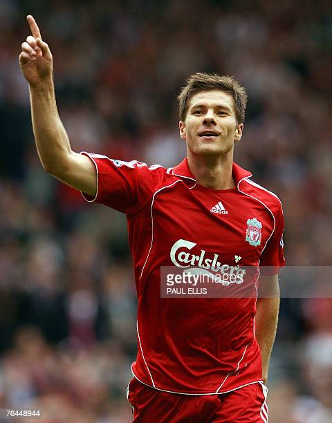 Liverpool's Xabi Alonso celebrates scoring against Derby County during their English Premiership football match at Anfield Liverpool northwest...