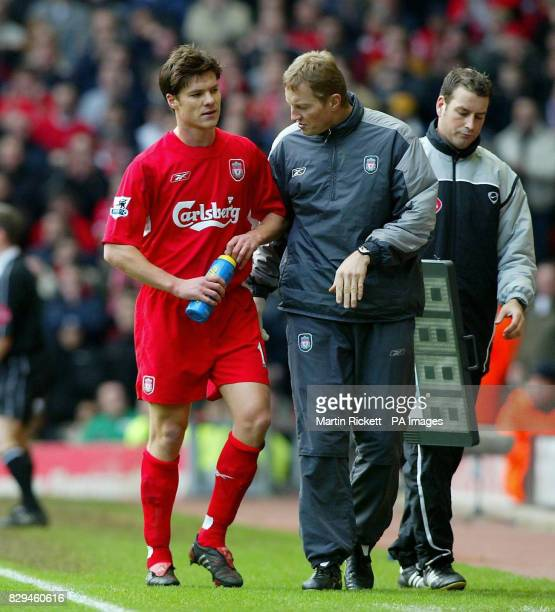 Liverpool's Xabi Alonso leaves the pitch after breaking his ankle