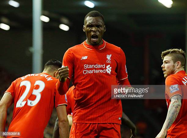 Liverpool's Zaireborn Belgian striker Christian Benteke celebrates scoring the opening goal of during the English Premier League football match...