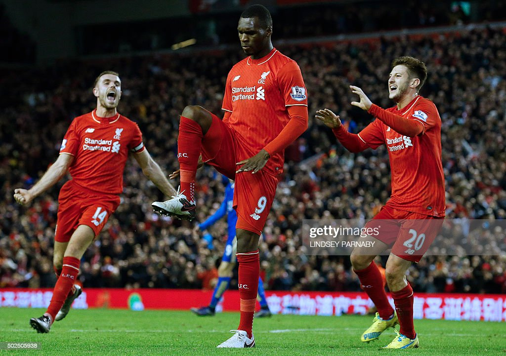 Liverpool's Zaire-born Belgian striker Christian Benteke (C) celebrates with teammates after scoring the opening goal of during the English Premier League football match between Liverpool and Leicester City at the Anfield stadium in Liverpool, north-west England on December 26, 2015. AFP PHOTO / LINDSEY PARNABY USE. No use with unauthorized audio, video, data, fixture lists, club/league logos or 'live' services. Online in-match use limited to 75 images, no video emulation. No use in betting, games or single club/league/player publications. / AFP / LINDSEY