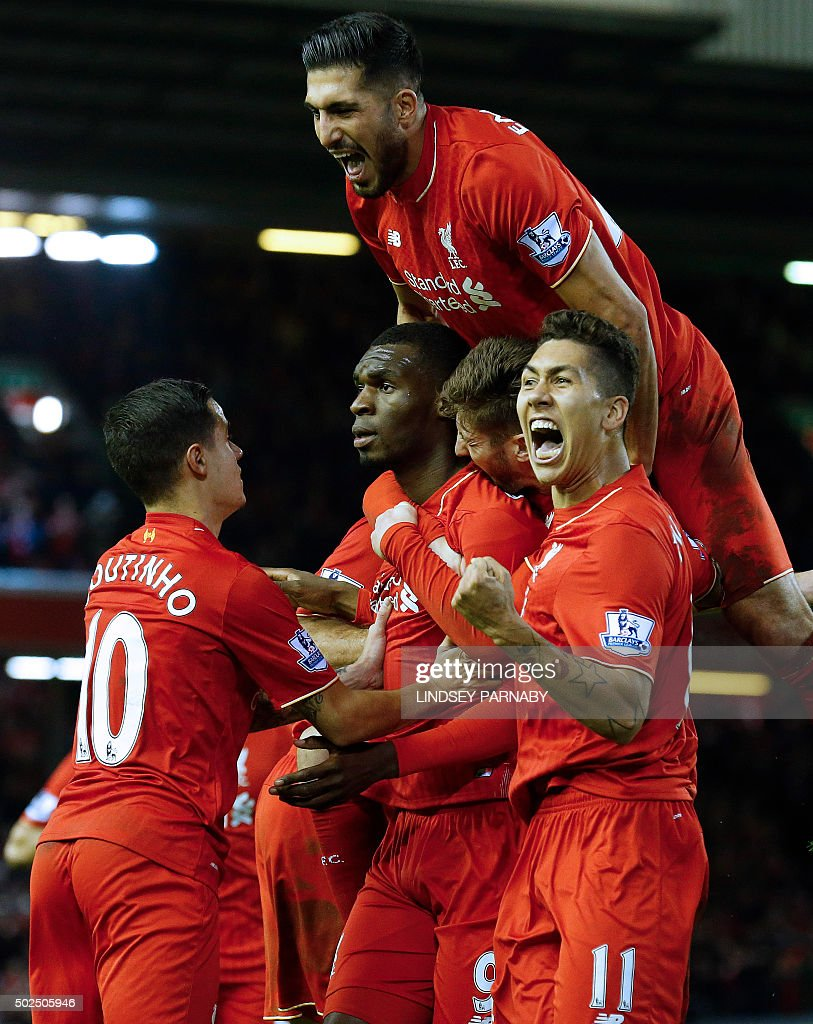 Liverpool's Zaire-born Belgian striker Christian Benteke (2nd L) celebrates with teammates after scoring the opening goal of during the English Premier League football match between Liverpool and Leicester City at the Anfield stadium in Liverpool, north-west England on December 26, 2015. AFP PHOTO / LINDSEY PARNABY USE. No use with unauthorized audio, video, data, fixture lists, club/league logos or 'live' services. Online in-match use limited to 75 images, no video emulation. No use in betting, games or single club/league/player publications. / AFP / LINDSEY