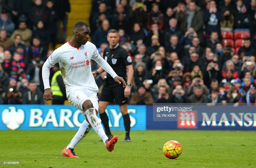 Liverpool's Zaire-born Belgian striker Christian Benteke scores their late winnning goal from the penalty spot during the English Premier League football match between Crystal Palace and Liverpool at Selhurst Park in south London on March 6, 2016. Liverpool won the game 2-1. / AFP / GLYN KIRK / RESTRICTED TO EDITORIAL USE. No use with unauthorized audio, video, data, fixture lists, club/league logos or 'live' services. Online in-match use limited to 75 images, no video emulation. No use in betting, games or single club/league/player publications. /