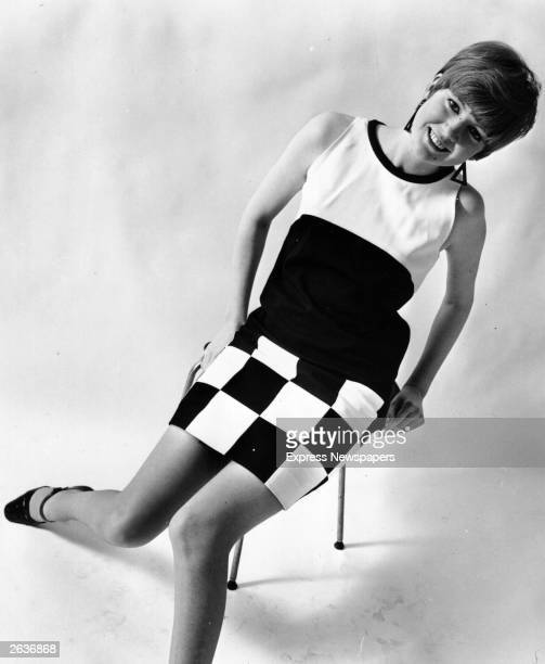 Liverpudlian pop singer Cilla Black modelling a day dress