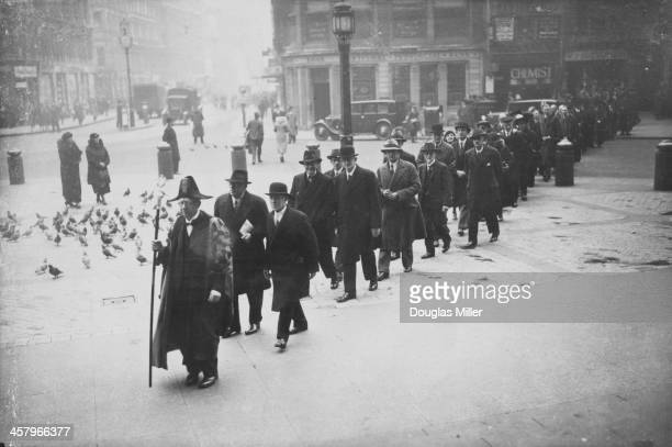 Liverymen of the Worshipful Company of Stationers on their annual Ash Wednesday parade to St Paul's Cathedral London 6th March 1935 After the service...