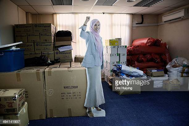 A livesize cardboard cut out of Nurul Izzah Anwar a current Member of Parliament from Malaysian opposition party Parti Keadilan Rakyat stands in...