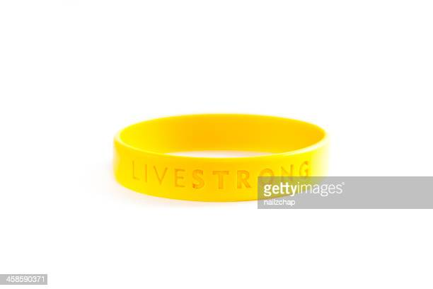 livestrong bracelet - bracelet stock pictures, royalty-free photos & images