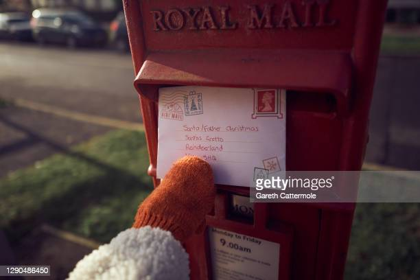 Livia Cattermole, the photographer's daughter, posts a letter to Santa via Royal Mail on December 06, 2020 in Essex, England. Writing letters to...