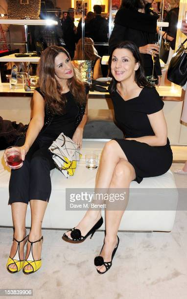 Livia Firth and Allegra Donn attend the Roger Vivier Prismick A/W 2012 Exhibition at the Roger Vivier Flagship Boutique on October 9 2012 in London...