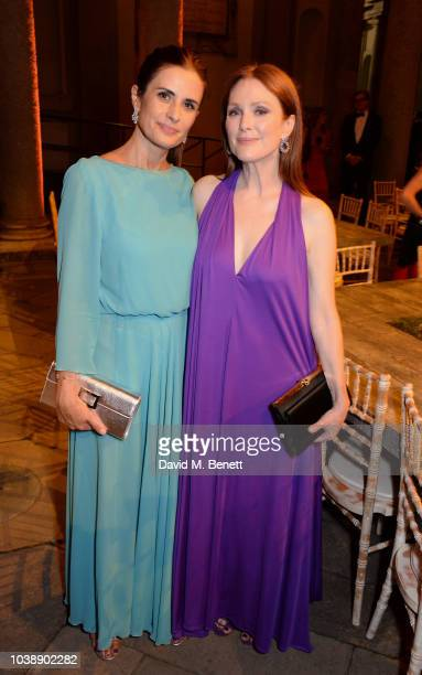 Livia Firth and Julianne Moore wearing Ferragamo attend The Green Carpet Fashion Awards Italia 2018 after party at Gallerie d'Italia on September 23...