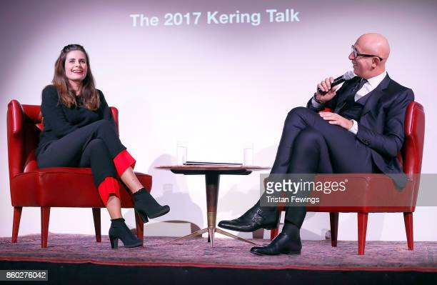 Livia Firth and Marco Bizzarri speak on stage during the 2017 Kering Talk at the London College of Fashion on October 11 2017 in London England
