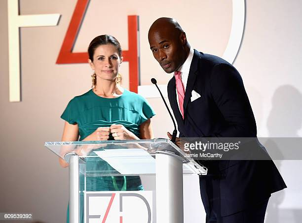 Livia Firth and Model Chris Collins speak at the Fashion 4 Development's 6th Annual Official First Ladies Luncheon on September 21 2016 in New York...