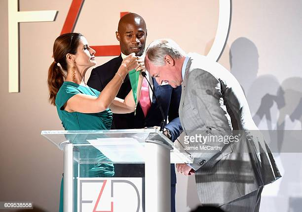 Livia Firth Unilever CEO Paul Polman and Model Chris Collins speak at the Fashion 4 Development's 6th Annual Official First Ladies Luncheon on...