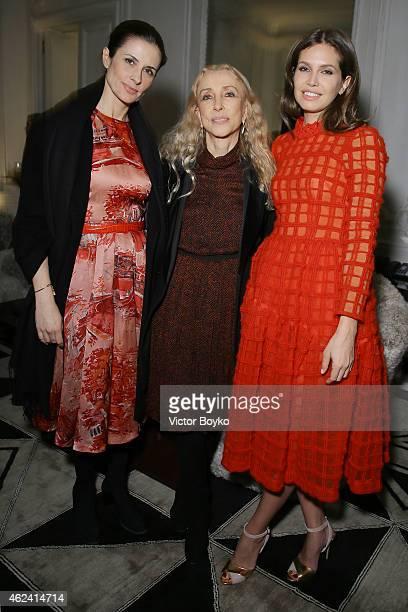 Livia Giuggioli Firth Franca Sozzani and Dasha Zhukova attend the party for Dasha Zhukova' cover for Wall Street Journal on January 27 2015 in Paris...