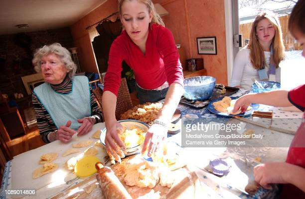 Livia Hooson center pats down dough off as her grandmother Mary Brexa left and sister Allie right prepare pierogi in their Boulder home on a recent...