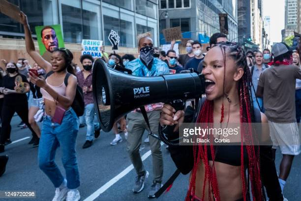 Livia Johnson an organization leader for Warriors in the Garden leads a group of hundreds of protesters in chants as they march from Trump...