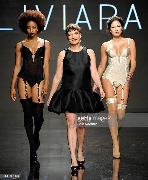 Liviara fashion designer walks the runway with models at Art Hearts Fashion Los Angeles Fashion Week presented by AIDS Healthcare Foundation on...