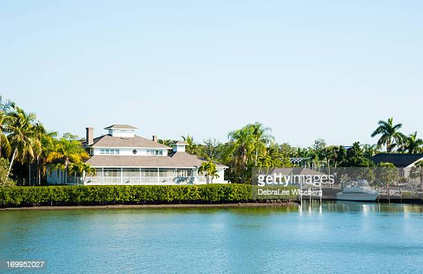 living along the canal - florida landscaping stock pictures, royalty-free photos & images
