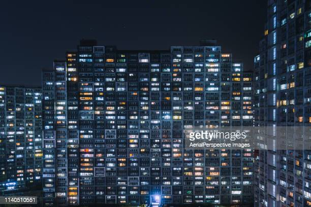 living apartment in beijing at night - blockchain stock pictures, royalty-free photos & images