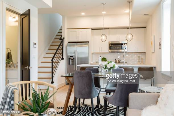 Living area and Kitchen with Powder Room in Unit 402 at Varnum on July 16, 2020 in Washington DC.