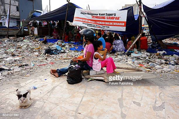 Living conditions in the local community of Fisheries Village after hundreds of houses were demolished by the city government in an eviction at Pasar...