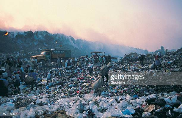 living from waste on smokey mountain,manila,philippines - manila philippines stock pictures, royalty-free photos & images
