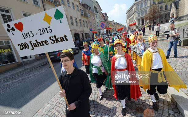 A 'living game of Skat' makes its way across the market square to the Skat Fountain in Altenburg Germany 05 May 2013 The procseesion kicked off the...