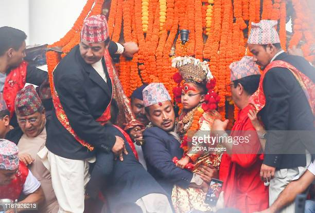 Living Goddess Kumari carried on a chariot during the main day of the Indra Jatra festival People across the country attended the eightday long...