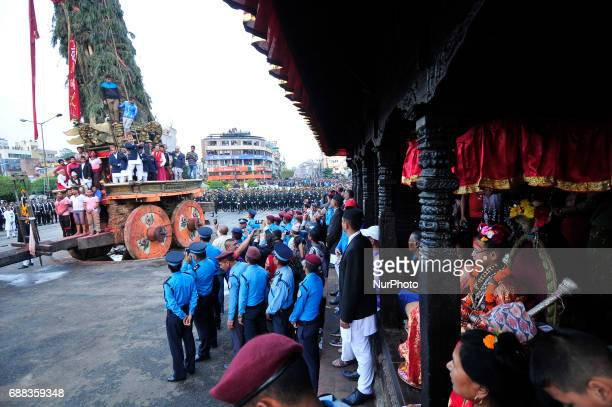 Living Goddess of Patan Unikia Bajracharya observing displaying the bejeweled vest known as Bhoto to the public from the chariot on celebration of...