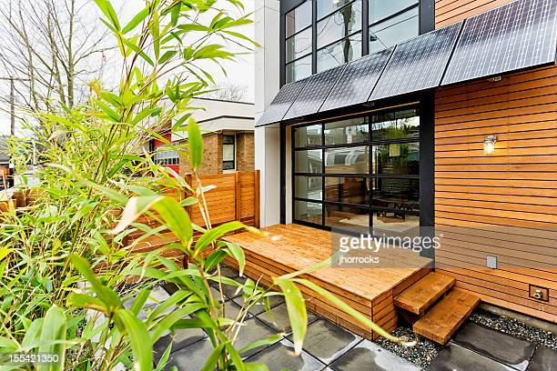 living green with solar panels - solar mirror stock pictures, royalty-free photos & images